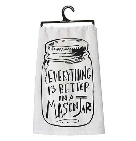 "Dish Towel that says ""Everything is better in a mason jar"" in black with a white background  hanging on a hanger."