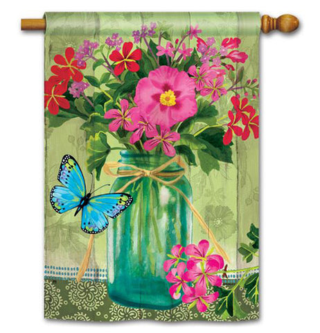 Flag showing a mason jar bouquet with pink and red flowers and a blue butterfly.