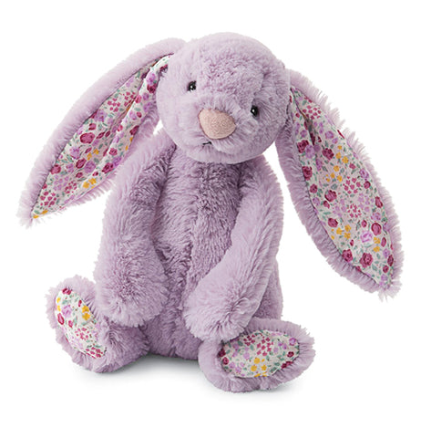 a plush purple bunny with floral inside ears and bottom of feet.
