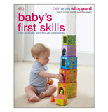 This front cover of the Baby's First Skills shows a toddler stacking five different sized blocks, each smaller than the next from bottom to top with the sixth and smallest block waiting to be stacked. Each block is a different color and has an opening on one side to place toys.