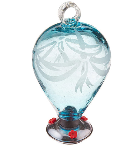 A light blue spherical glass hummingbird feeder has three red feeders for hummingbirds to feed through.