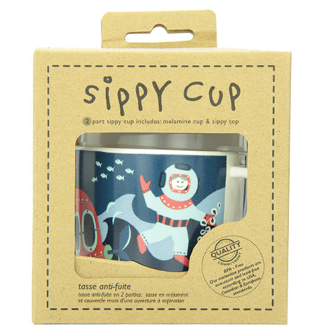 "The sipping cup with the diver, submersible, and fish in the ocean design is shown in its packaging. The words, ""Sippy Cup"" are shown at the top in black lettering."
