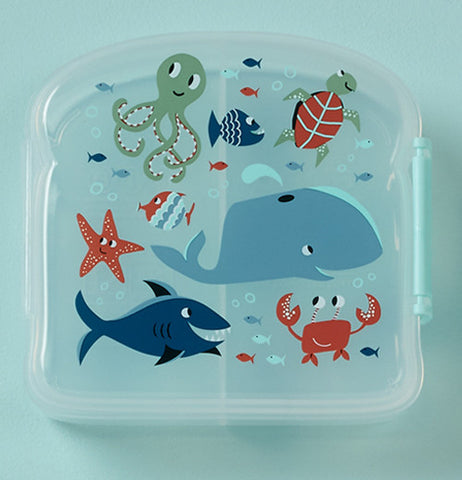 Blue sandwich box has sea animals on it.