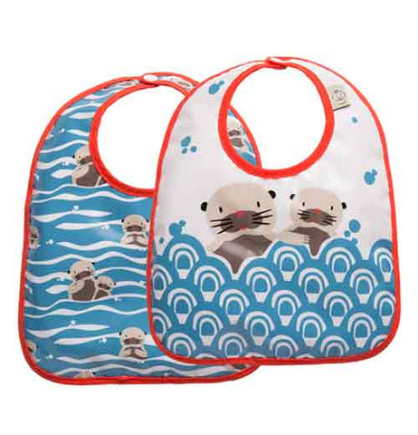 This image shows two bibs with two different designs, both with red outline around the bibs. One bib has a design of waves of blue water with baby otters scattered around. The second one has a design of blue water that fills the bottom half of the bib and the top half shows two otters with their bodies inside the water, but with their heads sticking out of the water.