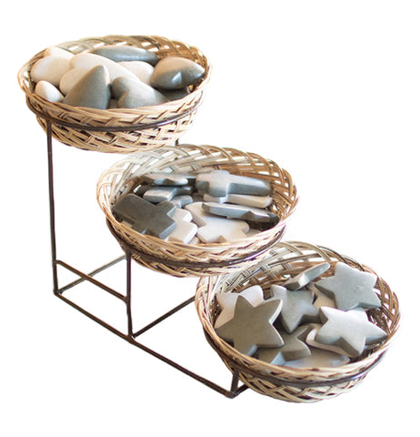 """Three Tiered Display"" basket with stand holds heart shaped stones in left basket, cross shaped stones in middle basket, and star shaped stones in right basket over a white background."