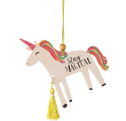 "This car air freshener is shaped like a unicorn with a hot pink horn, a rainbow mane and tail, a yellow tassel hanging down from its chest, and has a yellow string holding it by the mane. The words, ""Stay Magical"" are stenciled in black lettering across the middle of the unicorn's body."