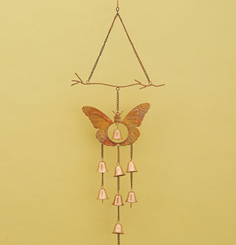 Butterfly wind chime hanging on a wall.