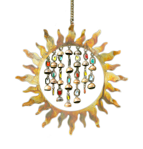 This Sun Shaped Wind Chime has Bronze Colored Bell Shaped chimes and Multicolored Tags Hanging Down in the middle of it.