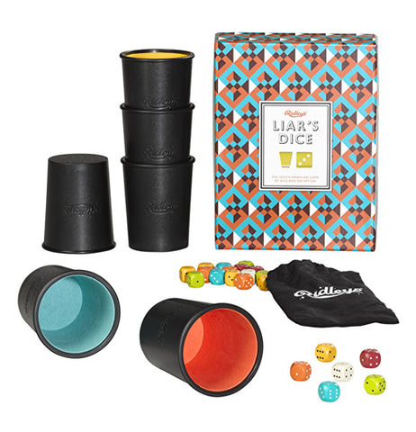 Liars dice game with blue, orange, white, and black box standing up with four cups stacked and two cups laying down with dice laying around black and white bag on a white background.