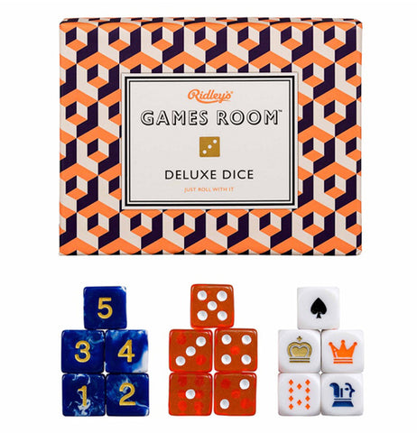 "At the top of this picture is a box with a black, white, and orange checkered pattern to it. In the middle of the box is a white sign with the words, ""Ridley's Games Room Deluxe Dice"" in orange and black lettering. A dice symbol sits in the middle of the sign. Below the box are sets of five different dice. One of those die sets is blue and yellow, the second red and white, and the third is white with playing card symbols covering them."