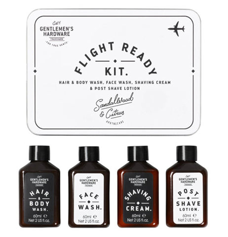"The white box with the words, ""Flight Ready Kit"" in black lettering is shown with its contents below it. The contents are small bottles of hair and body wash, face wash, shaving cream, and aftershave."