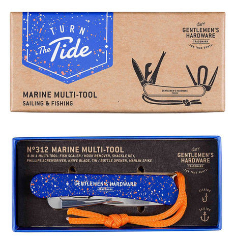 "The ""Marine"" Multi-Tool folded up in the bottom of the box with the tan lid above."