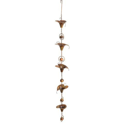 Flamed calla lily garden ornament with copper bells in between each lily.