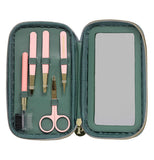 Green colored eyebrow kit laying open displaying five eyebrow tools used to groom the eyebrows.