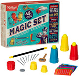 The magic kit box shown with its contents out; a few cups with some yellow balls, the yellow and black wand, the magic playing cards, a coin picking spoon, and a smaller red cup and yellow cup.
