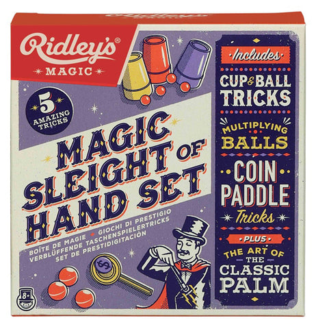 "This purple and red box features an illustration of several red balls under a red cup, yellow cup, and purple cup at the top. In the middle, against a white background, are the words, ""Magic Sleight of Hand Set"" in black lettering. At the bottom of the box is a picture of three red balls, a yellow coin paddle, and a magician performing a trick with a wand. On the far right side of the box is a black sign with a list of the magic items in yellow and white lettering."