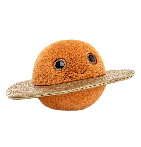 An anthropomorphic orange plush toy of a planet looks to the right corner with its' eyes. It has a gold colored ring around it.