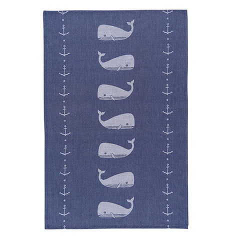 The blue dishtowel has white whales and white anchors running down the towel.