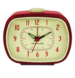 Red and off-white vintage styled alarm clock with black hands and red numbers.