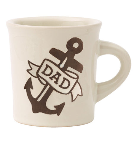 Cream colored mug with dad printed on it with anchor and ribbon