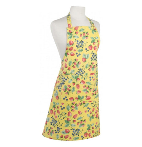 The yellow apron has strawberries and black berries on it.
