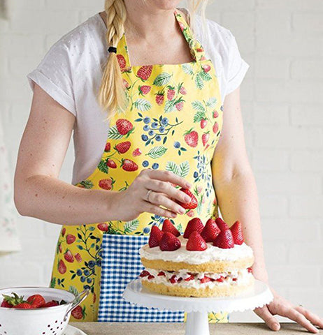This apron has pictures of fruit on it like strawberries and different berries.