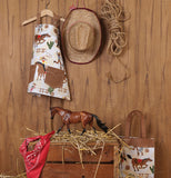 This rooting,tootin cowboy themed apron with cowboys dancing with a white and brown art design.the apron ties in the back.