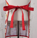 A red ribbon is tied on the back of the kid's Gnome Sweet Gnome Apron.