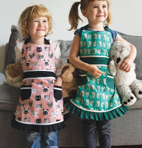 Apron Sally Cats Meow with the color of pink and green with cats on the apron.