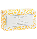 Soap that features a yellow and white flower design on its packaging on a white background.