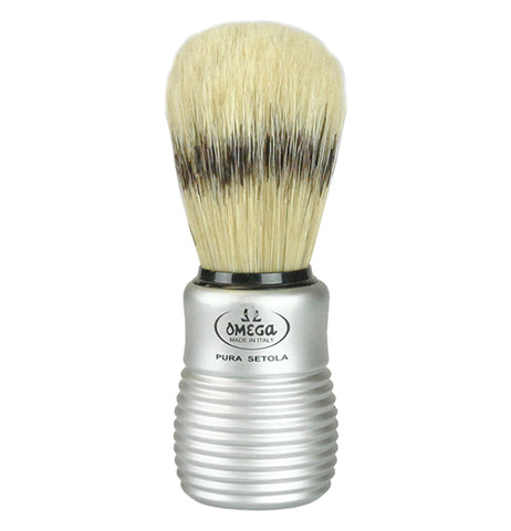 "Shaving  brush has a silver handle and tan brushes that says ""Omega Made In Italy Pura Setola."""