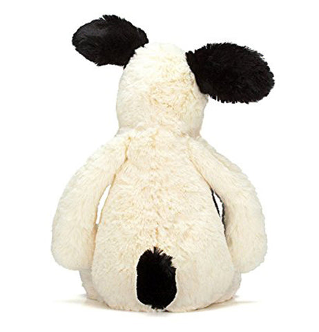 the back side of the white puppy with black spots