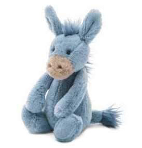 This is a stuffed donkey toy with gray and blue fur and a tan muzzle.