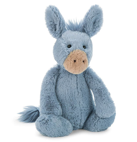 The stuffed donkey toy is shown from the front sitting down.