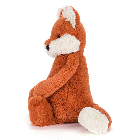 This image of the plush orange fox is shown from the side.