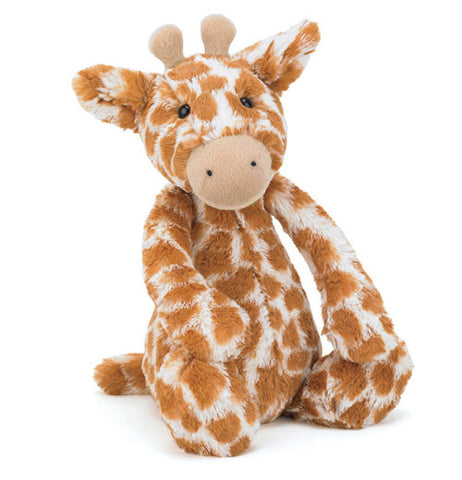 orange and cream colored plush giraffe front view