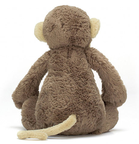The stuffed monkey plush toy is shown from the back.