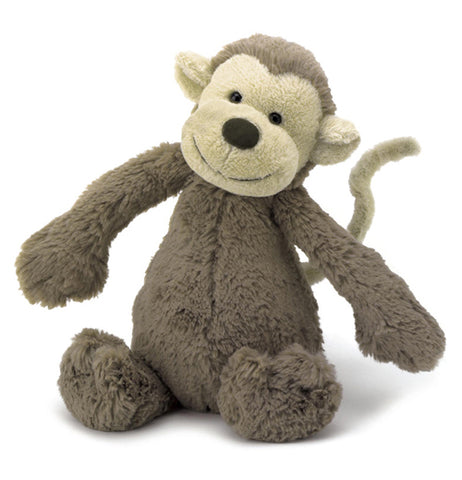 This stuffed plush toy is of a brown monkey with a white tail and a white face with a black nose.