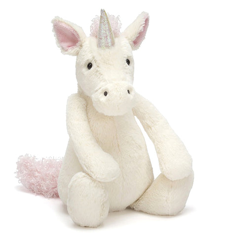The Bashful Medium sized Unicorn is cuddly stuffed white-colored animal with squish-squashy hooves, and a shimmery-soft horn on top of her head.