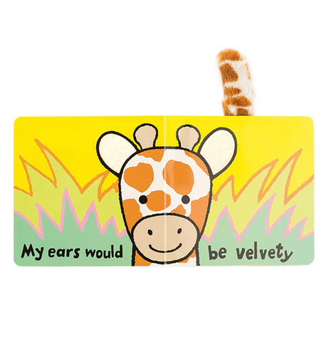 "The book is shown open to a page showing a giraffe's face sticking above grass. The words, ""My ears would be velvety"" are written across the bottoms of both pages in black lettering."