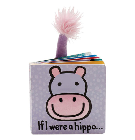 "This small baby book has a hippo's purple and pink face on a violet background. Below the hippo's head is the book's title, ""If I Were A Giraffe"" in black lettering. A small purple tail ending in a pink tuft sticks out of the top of the book's back page."