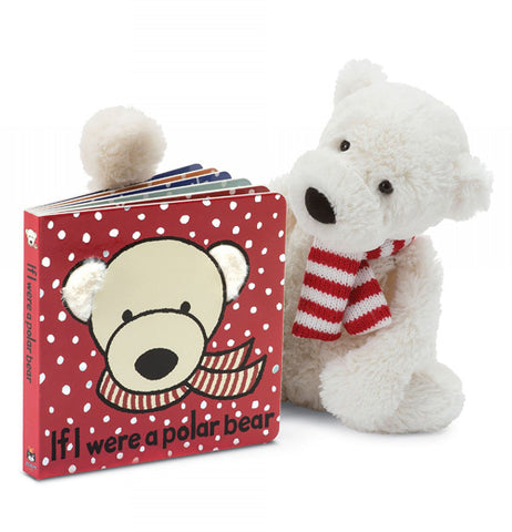 "The ""If I Were a Polar Bear"" book alongside a stuffed polar bear wearing a red and white scarf"