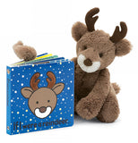 "The ""If I Were a Reindeer"" book sits alongside a stuffed brown reindeer toy."