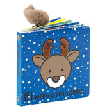 "This blue book cover with falling snow features a brown reindeer with the title, ""If I Were a Reindeer"" in black lettering."