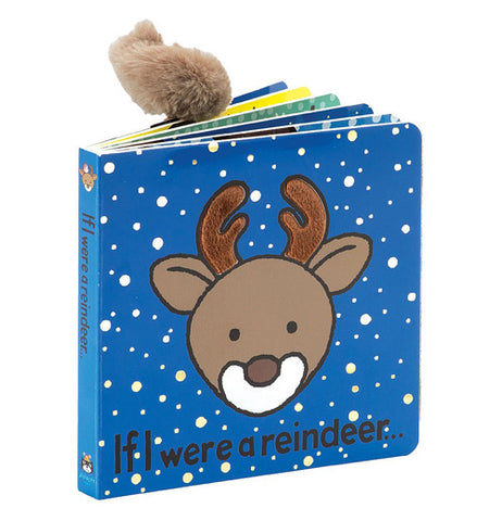 "A blue book cover with falling snow featuring a brown reindeer with the title ""If I Were a Reindeer"" in black lettering"