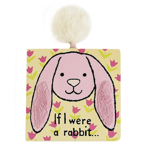 "This book is yellow with a pink floppy ear rabbit on the front that has textured furry ears. It says "" If I were a rabbit""."