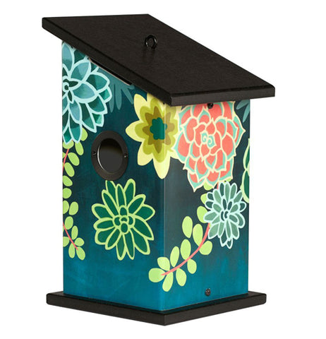 This dark blue-green birdhouse with a black roof and floor sports a design of bright green and blue succulent plants covering it.