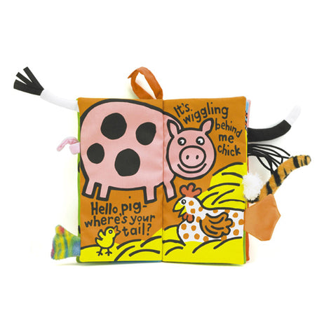"The ""Farm Tails"" Activity Book is open to a page with a pig, a chicken, and a baby chick."