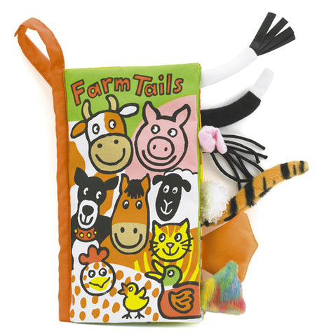"The ""Farm Tails"" Activity Book has pictures of farm animal faces and furry, fluffy farm animal tails coming out on the right side of the book."