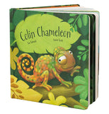 "The ""Colin Chameleon"" Board Book written and illustrated by Sue Samuels and Gavin Scott shows an illustration of the brownish-green little chameleon sitting on a green plant surrounded by green and yellow leaves."